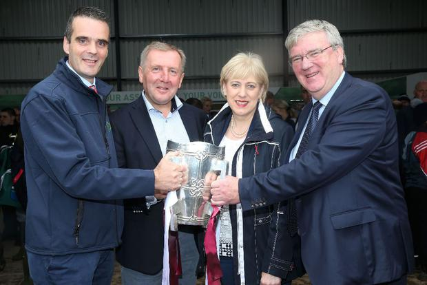 IFA President Joe Healy, the Minister for Agriculture Michael Creed, the Minister for Arts and Culture Heather Humphreys and Supermac's MD Pat McDonagh with the Liam McCarthy Cup at the National Ploughing Championships in Screggan