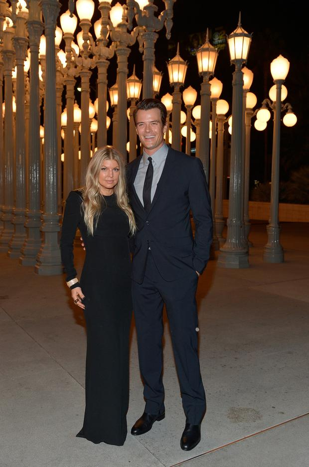 Fergie (L) and Josh Duhamel attend the LACMA 2013 Art + Film Gala honoring Martin Scorsese and David Hockney presented by Gucci at LACMA on November 2, 2013 in Los Angeles, California. (Photo by Charley Gallay/Getty Images for LACMA)