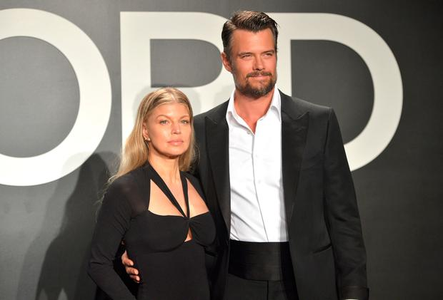Recording artist Fergie (L) and actor Josh Duhamel, both wearing TOM FORD, attends the TOM FORD Autumn/Winter 2015 Womenswear Collection Presentation at Milk Studios in Los Angeles on February 20, 2015. (Photo by Charley Gallay/Getty Images for Tom Ford)
