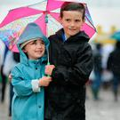 National Ploughing Championships 2017. Lucy (5) and David Kent (8) make their way through the site in the pouring rain. Picture; Gerry Mooney.