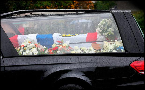 The remains of Louth GAA Player Brendan Reilly are brought from The Church of the Immaculate Conception in Tenure Co Louth for burial. Pic Steve Humphreys