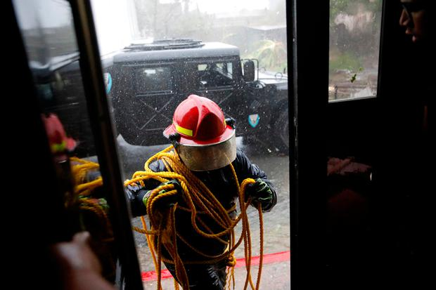 A rescue worker enters in to the Emergency Operation Centre after the area was hit by Hurricane Maria in Guayama, Puerto Rico September 20, 2017. REUTERS/Carlos Garcia Rawlins