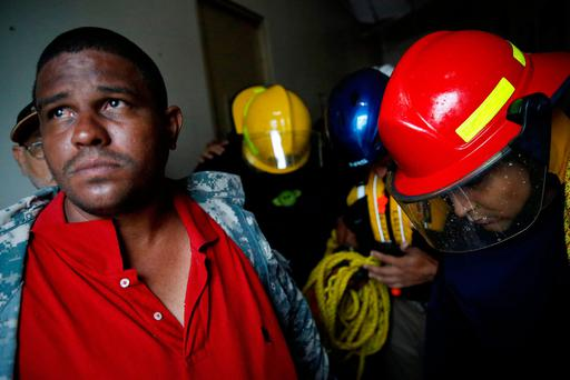 Rescue workers pray before walking out from the Emergency Operation Centre after the area was hit by Hurricane Maria in Guayama, Puerto Rico September 20, 2017. REUTERS/Carlos Garcia Rawlins