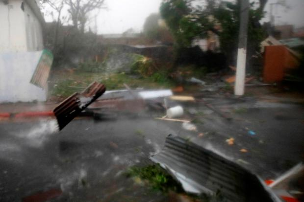 Constructions debris are carried by the wind after the area was hit by Hurricane Maria in Guayama, Puerto Rico September 20, 2017. REUTERS/Carlos Garcia Rawlins