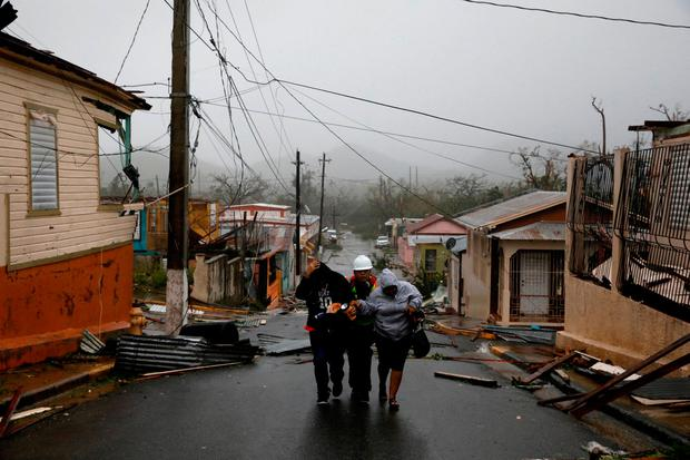 Rescue workers help people after the area was hit by Hurricane Maria in Guayama, Puerto Rico September 20, 2017. REUTERS/Carlos Garcia Rawlins TPX IMAGES OF THE DAY