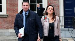 Garda Keith Harrison and his partner Marisa Simms arrive at Dublin Castle yesterday to hear evidence at the Charleton Tribunal. Photo: Stephen Collins/Collins Photos