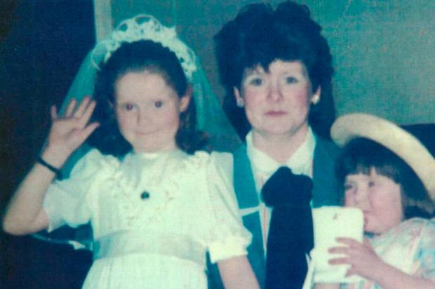 Fire victims Mary Ellen Byrne (8) (left) and her sister Kerrie Ann Byrne (3) (right), pictured with their mother Elizabeth Byrne