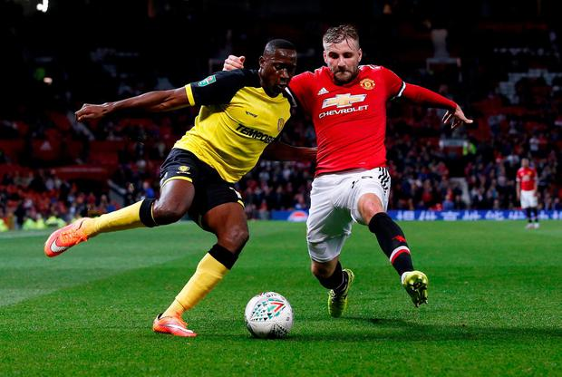 Burton Albion's Lucas Akins in action with Manchester United's Luke Shaw. Photo: Reuters