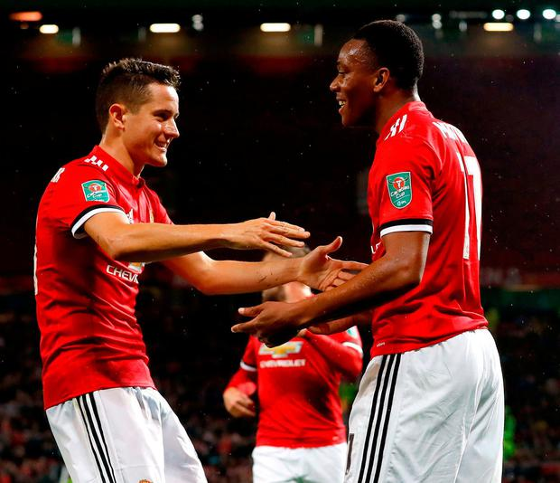 Manchester United's Anthony Martial celebrates scoring his side's fourth goal of the game with team mate Ader Herrera. Photo: Martin Rickett/PA Wire