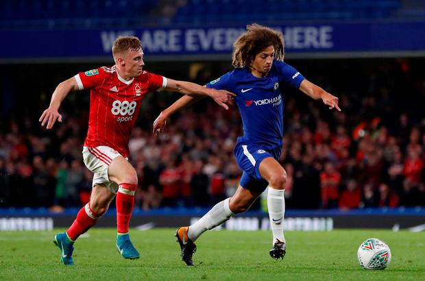 Chelsea's Ethan Ampadu in action with Nottingham Forest's Ben Osborn. Photo: Paul Childs/Action Images via Reuters