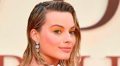 Australian actress Margot Robbie poses upon arrival for the World Premiere of the film,