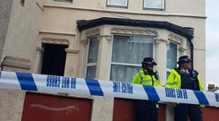Police outside a property in Thornton Heath, south London, after a teenager was arrested by detectives Photo: Catherine Wylie/PA Wire
