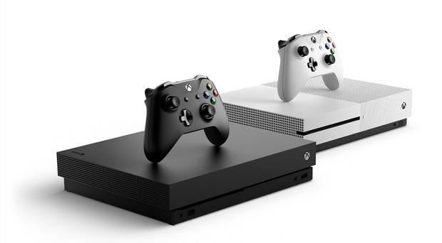 The Xbox One X (left) alongside its little brother the Xbox One S