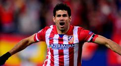 Diego Costa celebrating after scoring for Atletico Madrid in the second leg of their Champions League quarter-final against AC Milan in 2014. Photo: AFP/Getty Images