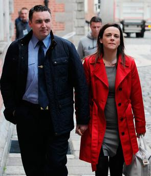 Garda Keith Harrison and partner Marisa Simms arrive at the tribunal yesterday. Photo: Collins