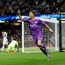 Ronaldo celebrates a goal for Madrid — but is his partnership the real deal for investors? Photo: Carl Recine/Reuters