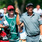 Padraig Harrington of Ireland plays his second shot on the 9th