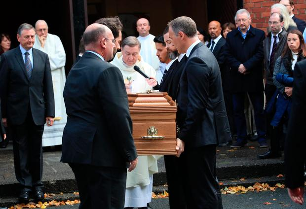 The remains of Jimmy Magee arrive at church