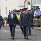 Minister for Justice Charlie Flanagan with Acting Garda Commissioner Dónall Ó Cualáin at the passing out ceremony of probationer Gardaí at the Garda College, Templemore this morning. Pic:Mark Condren