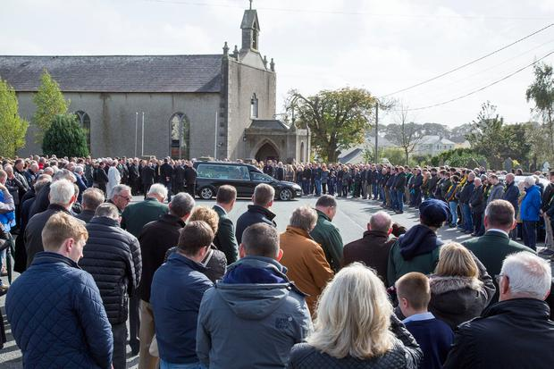 The remains of farmer, Martin Keogh pictured leaving The Church of St. Aidan's, Clongeen, Co. Wexford yesterday after funeral mass. Pic: Colin O'Riordain