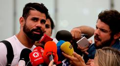 Diego Costa speaks to media upon arriving at Adolfo Suarez Madrid Barajas airport