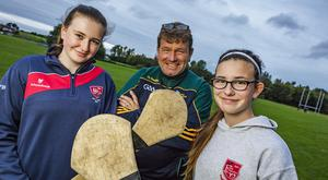 Kyran O'Brien at camogie training with his daughters Abby, 16 and Molly, 13, at Fingallians in Swords. Pic: Arthur Carron