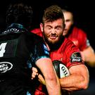 Jaco Taute of Munser is tackled by Tim Swinson of Glasgow Warriors during the Guinness PRO14 Round 4 match between Glasgow Warriors and Munster at Scotstoun Stadium in Glasgow. Photo by Rob Casey/Sportsfile
