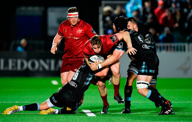 Chris Farrell of Munster is tackled by Ali Price of Glasgow Warriors. Photo by Rob Casey/Sportsfile