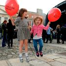 Ailbhe Reynolds Paul (6), from Kimmage, and pal Tess Foley (4), from Ranelagh, at Dublin Castle Photo: Caroline Quinn