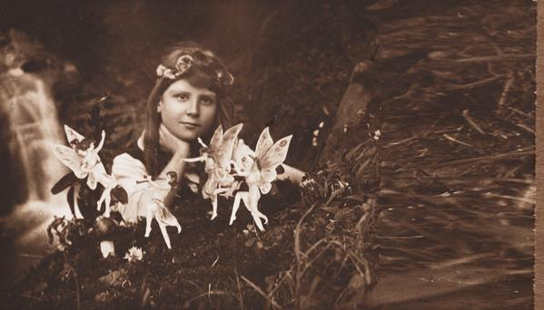 A photograph of Frances 'Alice' Griffiths taken by her cousin Elsie 'Iris' Wright, part of 'The Cottingley Fairies' series that served as inspiration for a novel by Hazel Gaynor (far below). Inset below: Ann O'Loughlin