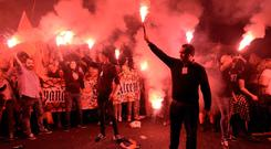 Demonstrators against independence light flares in Barcelona last night. Photo: Luis Genelluis/Getty Images