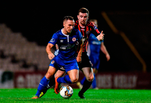 Graham Kelly of St. Patricks Athletic in action against Dan Byrne of Bohemians Photo: Sportsfile