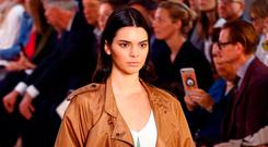 Model Kendall Jenner displays a creation from the Bottega Veneta Spring/Summer 2018 show at the Milan Fashion Week in Milan, Italy, September 23, 2017. REUTERS/Stefano Rellandini