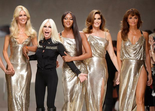 From left, Claudia Shiffer, Donatella Versace, Naomi Campbell, Cindy Crawford and Helena Christensen on the catwalk at the end of the Versace women's Spring/Summer 2018 fashion collection, presented in Milan, Italy, Friday, Sept. 22, 2017. (AP Photo/Luca Bruno) of the Versace women's Spring/Summer 2018 fashion collection, presented in Milan, Italy, Friday, Sept. 22, 2017. (AP Photo/Luca Bruno)