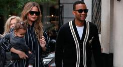 Chrissy Teigen and John Legend take their daughter Luna to The Ivy restaurant for lunch on September 11, 2017 in London, England. (Photo by Neil Mockford/GC Images)