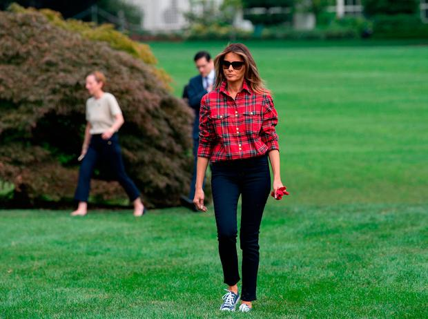 US First Lady Melania Trump arrives to work in the White House kitchen garden with children from the Boys and Girls Club of Greater Washington at the White House in Washington, DC, on September 22, 2017. / AFP PHOTO / BRENDAN SMIALOWSKIBRENDAN SMIALOWSKI/AFP/Getty Images