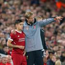 Jurgen Klopp the manager of Liverpool FC talks with Philippe Coutinho during the UEFA Champions League group E match between Liverpool FC and Sevilla FC at Anfield on September 13, 2017 in Liverpool, United Kingdom. (Photo by Alex Livesey - UEFA/UEFA via Getty Images)