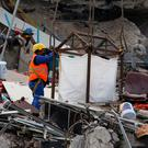 A rescue removes debris in the rubble of a collapsed building after an earthquake in Mexico City, Mexico September 23, 2017. REUTERS/Henry Romero