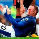 LIVERPOOL, ENGLAND - SEPTEMBER 23: Wayne Rooney of Everton goes down injured with a face injury during the Premier League match between Everton and AFC Bournemouth at Goodison Park on September 23, 2017 in Liverpool, England. (Photo by Matthew Lewis/Getty Images)