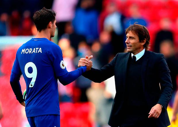 STOKE ON TRENT, ENGLAND - SEPTEMBER 23: Alvaro Morata of Chelsea is congratulated his team's 4-0 victory and his hat trick by manager Antonio Conte after the Premier League match between Stoke City and Chelsea at Bet365 Stadium on September 23, 2017 in Stoke on Trent, England. (Photo by Richard Heathcote/Getty Images)
