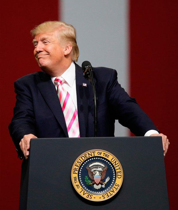 President Donald Trump smiles at the crowd as he speaks at campaign rally in support of Sen. Luther Strange, Friday, Sept. 22, 2017, in Huntsville, Ala. (AP Photo/Brynn Anderson)