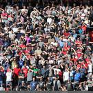 Manchester United fans shield their eyes from the sun during the Premier League match between Southampton and Manchester United at St Mary's Stadium on September 23, 2017 in Southampton, England. (Photo by John Peters/Man Utd via Getty Images)