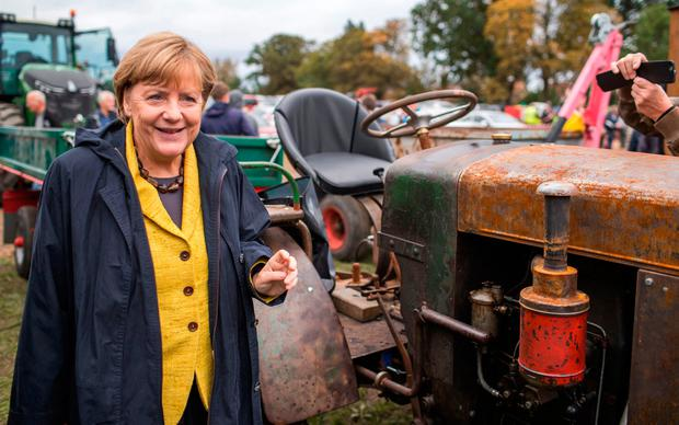 German chancellor Angela Merkel arrives at the harvest festival in Lauterbach, Germany on the Baltic Sea island of Ruegen, Saturday, Sept. 23, 2017, one day ahead of the German Federal elections on Sunday. (Jens Buettner/dpa via AP)