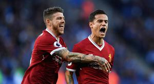 Philippe Coutinho of Liverpool celebrates scoring his sides second goal with Alberto Moreno during the Premier League match between Leicester City and Liverpool at The King Power Stadium on September 23, 2017 in Leicester, England. (Photo by Michael Regan/Getty Images)