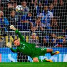 Liverpool's Simon Mignolet saves Jamie Vardy's penalty. Photo: Getty