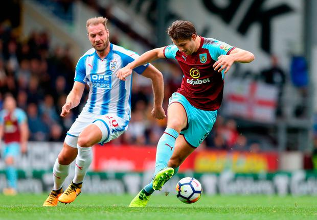 James Tarkowski of Burnley controls the ball under the pressure of Laurent Depoitre. Photo: Getty