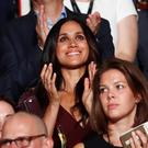 Meghan Markle (center R, wearing maroon), girlfriend of Britain's Prince Harry, watches the opening ceremony of the Invictus Games in Toronto, Ontario, Canada September 23, 2017. REUTERS/Mark Blinch