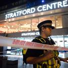 Emergency services at Stratford Centre in east London, following a suspected noxious substance attack where six people have been reported injured. Photo : /PA Wire