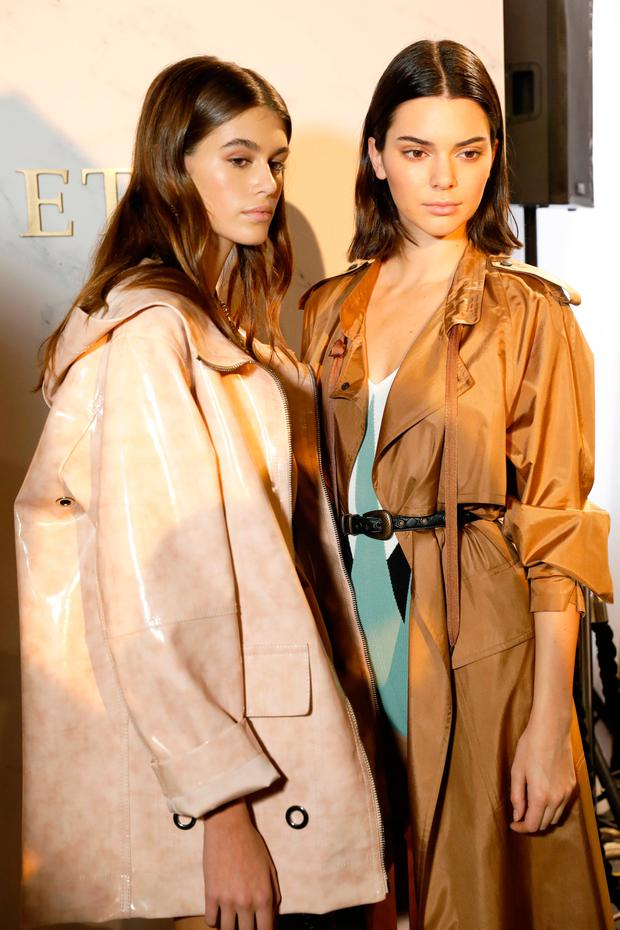 Kaia Gerber and Kendall Jenner are seen backstage ahead of the Bottega Veneta show during Milan Fashion Week Spring/Summer 2018 on September 23, 2017 in Milan, Italy. (Photo by Tristan Fewings/Getty Images for Bottega Veneta)