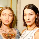 Gigi Hadid, Bella Hadid and Hailey Baldwin are seen backstage ahead of the Bottega Veneta show during Milan Fashion Week Spring/Summer 2018 on September 23, 2017 in Milan, Italy. (Photo by Tristan Fewings/Getty Images for Bottega Veneta)